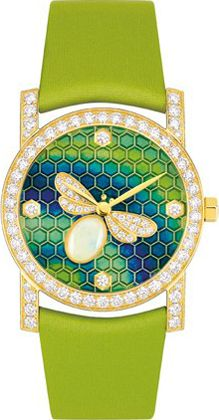 "CHAUMET ""Bee My Love""collection.-18K yellow gold and round-cut diamonds watch.The wings of the bee with its little body of white opal cabochon are adorned with diamond.The dial is an enamel miniature and mosaics.The model is equipped with a textile strap with the color matching the enamel, decorating the dial."