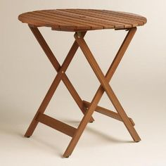 One of my favorite discoveries at WorldMarket.com: Round Natural Wood Mika Folding Dining Table