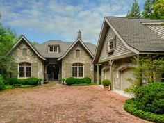 Mountain Lake Properties NC | For Sale in: LAKE TOXAWAY, NC | 53 S East Shore Drive | Offered for $3,087,000