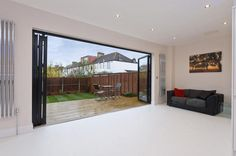 Nice radiators on either side of the bifold doors. Semi Detached, Detached House, Kitchen Layout, Kitchen Design, Designer Radiator, External Doors, Open Plan Living, Brick Wall, Radiators