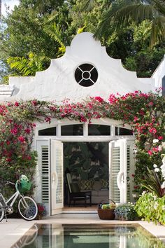 Palm Beach Chic - Design Chic- great pool house…love the climbing roses!