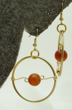 Carnelian round bead on gold wire wrapped circle by PrettiesbyRJ, $9.00