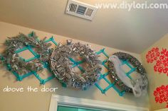 DIY Wreathe Hanging Storage.  Come check out the small laundry room makeover on www.diylori.com