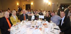 """Left to right: Dick and Linda Fisher, Ray Mishler, JT Maxwell, Robin Maxwell, John Raymond  and Jim Miller at the Miller Financial Group table. """"Jimmy Miller's Bracket Breakfast for Piedmont CASA"""" on March 14, 2016. Image by Jennifer Byrne Photography."""