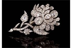 Fine 19th century diamond tremblant floral spray brooch with pear cut, cushion cut and old cut diamonds.