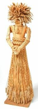 This corn dolly is in the form of the Ceres, the goddess of the harvest, who was thought to give live to the corn and to die when it was harvested. For this reason, her image was woven from the last sheaf to be reaped. This dolly consists of a large, full sheaf of corn tied to form the figure of a lady with clasped hands. Plaited bands around the arms, waist and neck give the figure its shape, and the head is formed form a full bunch of corn ears. It was made by Alec Coker. (MERL/86/148)