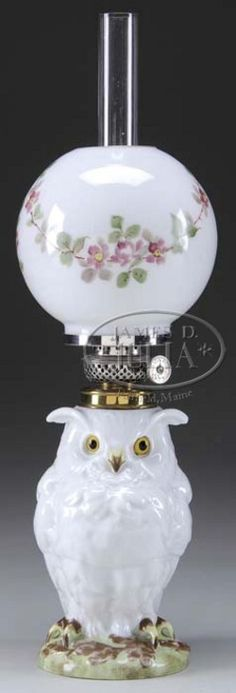 lighting, America, Miniature figural lamp, reference H2-227. White porcelain owl with inset eyes of yellow and black; white milk glass ball shade with pink and freen floral decor. P & A Victor burner. Circa 1850-1900