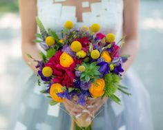 Purple, Yellow and Magenta Bridal bouquet. Craspedia, Ranunculus, Peonies, Succulents