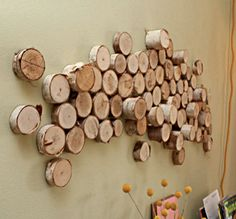 I'm always looking for good ideas of ways to incorporate rustic, natural elements without being country or kitchy. This wood wall sculpture fits the bill!