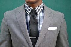 Gray jacket and checkered shirt