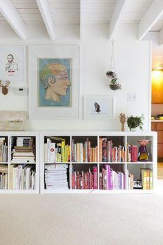 Ikea done right. downstairs / horizontal ikea expedit bookshelves in kate jordan and david chanpong's home in philadelphia; photo by nick steever. Ikea Expedit Bookcase, Ikea Kallax, Ikea Shelves, Expedit Regal, Kallax Shelving, Cube Shelves, White Shelves, Low Bookshelves, Book Shelves