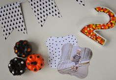 Black and white invitations and décor compliment bold colors in this #Halloween themed #birthday #party.