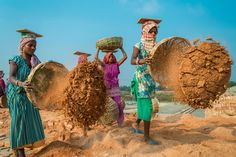Women make bricks in a field in India in this National Geographic Your Shot Photo of the Day.