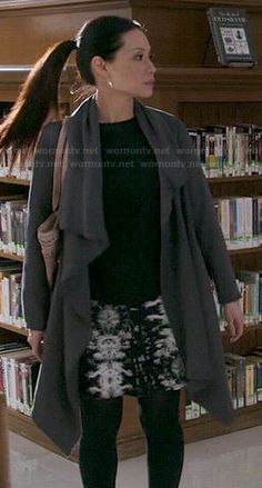 Joan's black top with white sleeves, grey coat and printed skirt on Elementary.  Outfit Details: https://wornontv.net/47798/ #Elementary
