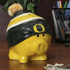 UO/8784973581/887849735818/_A_ Each piggy bank comes specially molded, made of resin and hand painted. . Made By Casey's Distributing