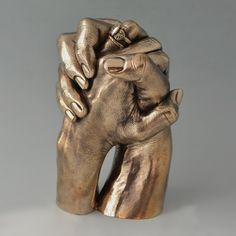 Hands Entwined in Bronze