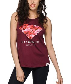 Get next level style with this pure cotton muscle tee that features a boyfriend fit with cut-off sleeves and a rose print Diamond graphic at the front.
