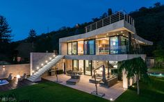 Modern luxury lakeside villa at Lake Balaton, Hungary by Stoa Studio Modern Luxury, Luxury Villa, Beach House, Relax, Photo And Video, Mansions, Studio, House Styles, Hungary