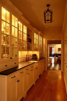 Narrow Butler's Pantry with huge storage on one side. Practical and useful hallway from the kitchen to Dining area.
