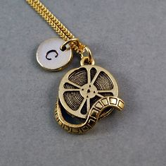 Film Reel Necklace Movie reel 24K yellow by ShortandBaldJewelry, $19.75 PERFECT for my love of films!!!!!!