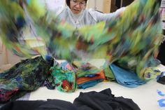 Maris Cavanagh with her  hand dyed silks she will wet felt into a masterful inner lining for Deb Hartman's refashioned coat we are collaborating on. SPLASH it became.