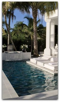 White marble paves an Egyptian-inspired Miami terrace and pool by interior designer Juan Montoya.