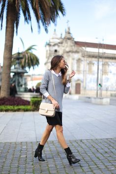 Silvia Garcia demo's the knitted sweater and shirt trend. We recommend wearing the look with a simple A line skirt and ankle boots to keep to a minimalist style. Sweater: Oxygene, Shirt: À Bicyclette, Skirt: Zara, Boots: Mango.