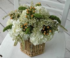 White & Green- white hydrangeas, andromeda, millet and peach hypericum berries