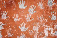 Fotobehang: Betonnen Muur met Handen