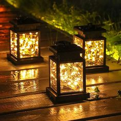 """Creates a warm wonderful feeling in your yard! These solar lanterns can either sit flat or be hung where you see fit. Made from a polymer blend, so they won't rust, will last a long time and handle the weather. Work well on patios, porches, pergolas, gazebos, decks and more! • Includes: Hanger, Lantern, Solar Panel and Lights • 3.5"""" x 3.5"""" x 5"""" • IP65 Rated Waterproof • 6 Hours Charge Time • 8 Hours of Light Solar Led Lights Outdoor, Led Solar, Solar Led String Lights, Solar Lamp, String Lights Outdoor, Outdoor Lighting, Battery Lamp, Led Garden Lights, Outdoor Lantern"""