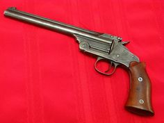 Smith and Wesson M1891 1st Model target pistolsManufactured by S&W c.1893-1911 at around 862 units. .22LR single shot top-break action with automatic extractor, single action trigger, made from...