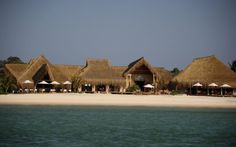 Azura hotel is a castaway fantasy: a remote retreat of luxury thatched villas on Benguerra Island's sunny shores. Breakfast On The Beach, Hotel Staff, Best Cleaning Products, Thatched Roof, Desert Island, Hotel Interiors, Blue Lagoon, The Locals, National Parks