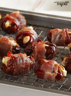 These tasty appetizer bites are the perfect mix of sweet and savoury. Stuffed with feta cheese and almonds, and then wrapped in bacon, these warm Bacon-Wrapped Feta & Almond Stuffed Dates are sure to become one of your favourite appetizers. Bacon Dates, Bacon Wrapped Dates, Easy Appetizer Recipes, Yummy Appetizers, Feta, Date Recipes, Brunch, Buffet, How To Eat Paleo