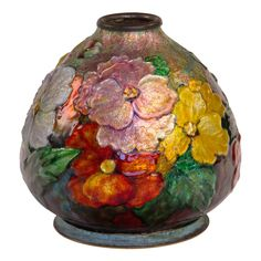 "Enameled All Over Floral Vase by, Camille Faure  French  1935  A French Art Nouveau enamel over copper ""All Over Floral"" vase by, Camille Fauré decorated with all over various flora against an iridescent pink and leaf background. The vase is signed, ""C. Fauré. Limoges""    circa 1925"