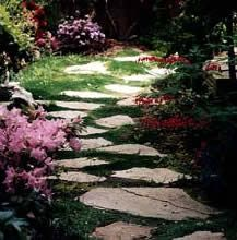 """""""spaced-out"""" stones. :) Means we need fewer of them. These would run between the front walk and the driveway."""