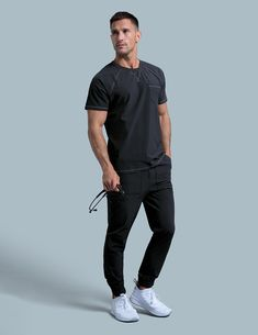Crew Neck Raglan Top in Black is a contemporary addition to men's medical scrub outfits. Shop Jaanuu for scrubs, lab coats and other medical apparel. Scrubs Outfit, Scrubs Uniform, Men In Uniform, Scrubs Pattern, Stylish Scrubs, Medical Photography, Hot Doctor, Medical Uniforms, Sports Uniforms