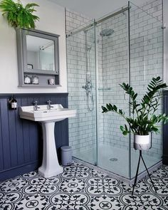 It's all about the monochrome tiles and beautiful dark blue panelled wood. Wood Panel Bathroom, Bathroom Paneling, Bathroom Artwork, Bathroom Styling, Bathroom Interior Design, Moroccan Tile Bathroom, Green Bathroom Tiles, Bathroom Taps, Blue Tiles