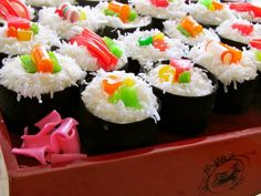 Sushi Cupcakes - keep it super simple using choc cupcakes in black cupcake liners for 'seaweed', icing & white sprinkles for 'rice', & cut up assorted color gum drops in center for 'filling'