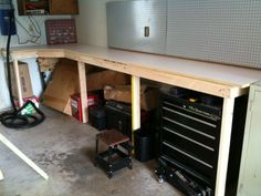 "I recently wrapped up the construction on my new work surface / workbench in the garage at our new home. The final measurements are 12 feet long, 2 feet deep, with a slightly larger angled corner work area. There was an existing metal cabinet that I wanted to match the bench height to, so the entire work surface is a very comfortable 42"" height - which just happens to match the ""belly-button height"" guideline for building benches, too! The top is a dual-layer construction with..."