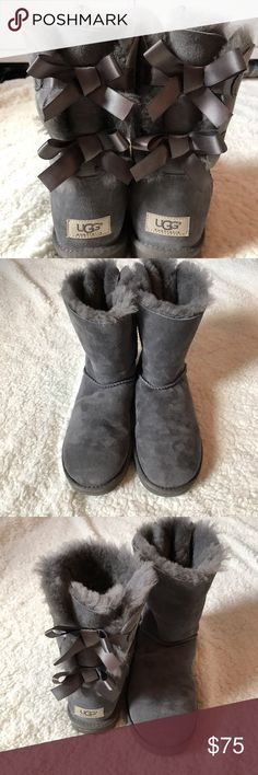UGG Bailey Bow Boots Authentic UGG Bailey Bow boots. Worn only a few times. Some sign of wear, mostly dirt, shown in photos. Otherwise kept in great condition. Wonderful warm boots! Women's size 8. I'm open to reasonable offers! UGG Shoes Winter & Rain Boots