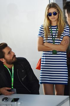 Beautiful in blue: The 20-year-old model looked laid-back in a lose-fitting blue and white striped shirt dress