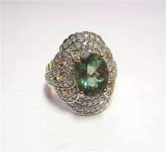 Green Aquamarine Ring - A beautiful 2.25ct green aquamarine/green beryl with 1.00ct of diamonds set in a 14kt yellow and white gold mounting. K411016 (subject to prior sale) – Lilliane's Jewelry – 4101 W. 83rd St. Prairie Village, KS 66208 – 913-383-3376 –
