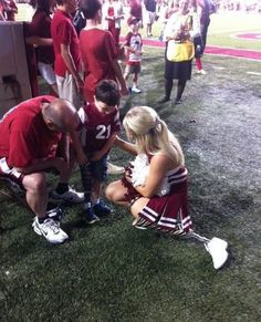 Love this pic! Patience Beard - University of Arkansas cheerleader with young fan