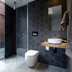 hexagonal black shower tiles