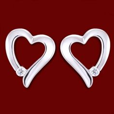 Gold earrings, diamonds, hearts Gold earrings, Au 750/1000 (18K white gold). Studs with friction back. With diamonds. Diamond quality VS, color G-H. Manual sorting grade. We provide a commercial certificate. Jewelry is thoroughly checked and hallmarked by the State Assay Office (Official State Authority). White gold, heart-shaped earrings are decorated by a brilliant cut diamond with a total weight of approx. 0.044ct. Enchanting and gentle earrings will highlight feminine elegance and charm…