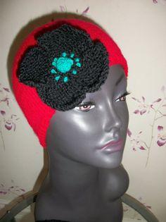 Red beanie cloche hat with black poppy. $24.00, via Etsy.
