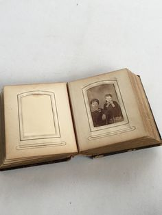 Victorian Photo Album Leather Cover Antique Sale by GardenBarn on Etsy https://www.etsy.com/listing/264421573/victorian-photo-album-leather-cover