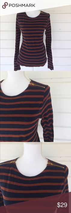 J Crew Navy and Burnt Orange Nautical Striped Tee Ahoy! Gorgeous navy and orange long sleeve tee with gold zipper details. Excellent condition for sailing the seven seas (or mimosas) with your crew. Causal and cheerful, this color combination is perfect year round. Gold zippers add some metallic punch to this great shirt. Size S, fits true to size. Fabric tag cut out, but appears to be a soft cotton linen blend. Offers always warmly received. J. Crew Tops Tees - Long Sleeve