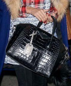 """Olivia Palermo carrying a classic-looking Givenchy """"Antigona"""" bag with a luscious crocodile leather finish"""