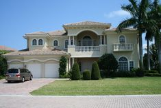 Classic Mediterranean style with towering covered entrance.  Spanish / Mediterranean House Plan # 611143